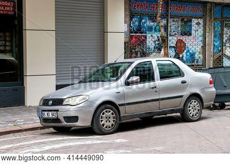 Istanbul, Turkey - February 11, 2021: Grey Sedan Car Fiat Albea In The City Street.