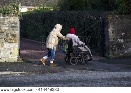 Senior Elderly Vulnerable Person In Wheelchair For Mobility