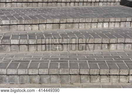 Rows Of Gray Steps Of Gray Paving Slabs Laid Out Evenly, Consistently And Tightly To Each Other.