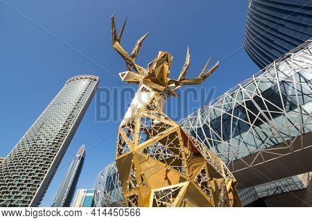Dubai, United Arab Emirates - 09 December, 2018: View Of Golden Deer And Modern Skyscrapers In The C