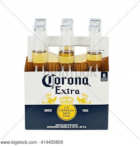 Ukraine, Kyiv - February 23. 2021: A 6 Pack Of Corona Extra Beer Isolated On White Background, Side