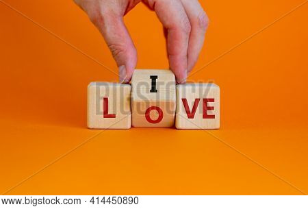 Live Your Love Symbol. Businessman Turns Cubes And Changes The Word 'live' To 'love'. Beautiful Oran