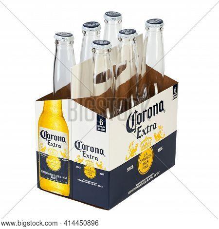 Ukraine, Kyiv - February 23. 202: A 6 Pack Empty Of Corona Extra Beer Isolated On White Background,