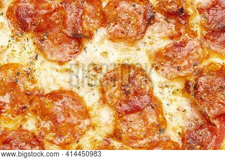 Background Pizza Pepperoni. Top View Of Hot Pepperoni Pizza.
