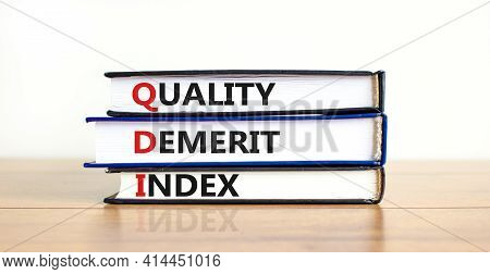 Qdi, Quality Demerit Index Symbol. Books With Words 'qdi, Quality Demerit Index'. Beautiful White Ba