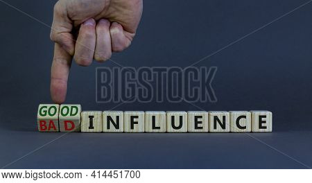 Good Or Bad Influence Symbol. Businessman Turns Cubes And Changes Words 'bad Influence' To 'good Inf
