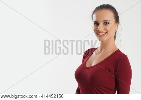 Portrait Of Young Beautiful Cute Cheerful Girl Smiling Looking At Camera Over White Background. Woma
