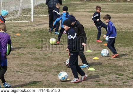 Odessa, Ukraine - 03.27.21: Children Play Football. Little Ones Go In Sports, Learn To Play Football