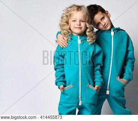 Fashion Stylish Sportive Children Studio Portrait With Copy Space. Boy Hugging Girl. Positive Childr