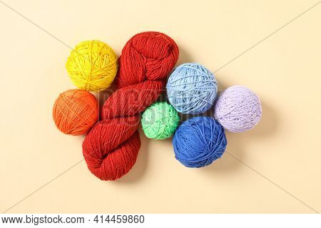 Colorful Woolen Yarns On Beige Background, Flat Lay