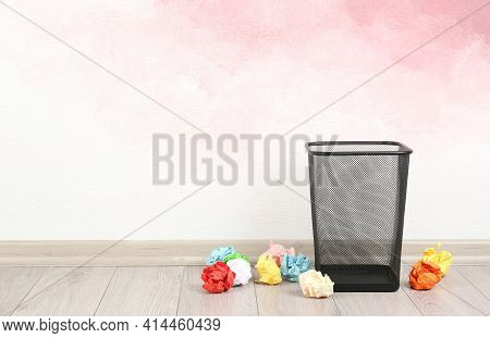 Basket With Crumpled Paper Balls Near Pink Wall. Space For Text