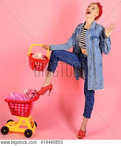 Smiling Woman With Full Cart At Supermarket. Pinup Girl With Shopping Basket.
