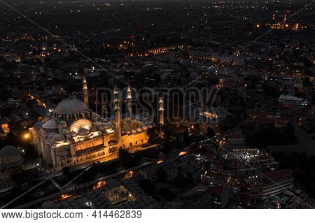 Night Aerial Shot Of Istanbul Turkey. Blue Mosque Glows In The Dark Of Night Surrounded By The Bustl