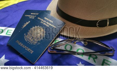 Brazilian Passport With Brazilian Flag In The Background.