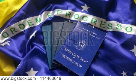 Brazilian Work Documents And Social Security Document On The Brazilian Flag.