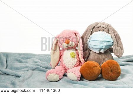 A Sick Sad Plush Toy In A Mask. Flu Colds Disease Virus Bacterium. Plush Donkey And Pink Bunny Toy W