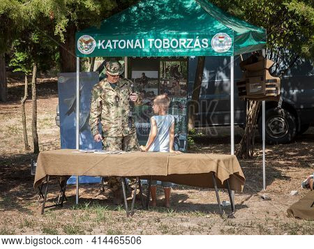 Kelebia, Hungary - July 23, 2017: Hungarian Solider Letting Children Play With Automatic Guns During