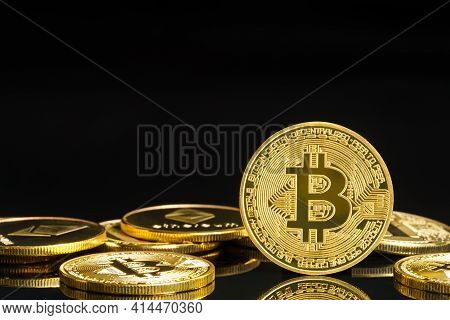 Golden Coins With Bitcoin Symbol On Black