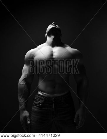 Black And White Portrait Of Tall Muscular Man, Athlete With Perfect Built Body Standing Shirtless Wi