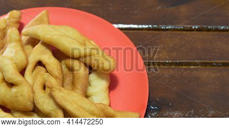 Fried Wheat Dumplings Known As Chiacchiere Or Cat's Ear In Selective Focus