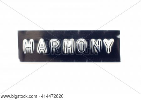 Embossed Letter In Word Harmony On Black Banner With White Background