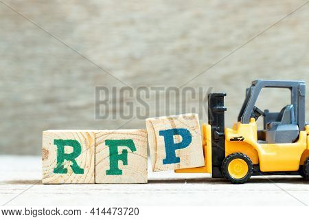 Toy Forklift Hold Letter Block P To Complete Word Rfp (abbreviation Of Request For Proposal) On Wood