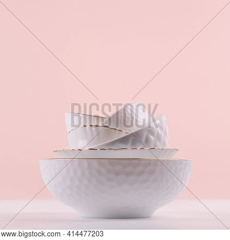 White Elegant Plates In Stack With Thin Golden Bezel, Bizarre Texture On White Wooden Table, Pastel