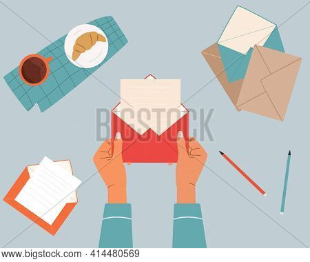 Hands Holding An Opened Envelope. Envelopes And Letter On Table. Top Down View. Correspondence And M
