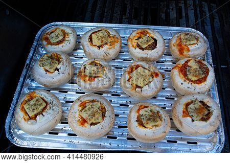 Stuffed Portobello Mushrooms Stuffed With Mozzarella And Gorgonzola Cheese And Aromatic Herbs On A B