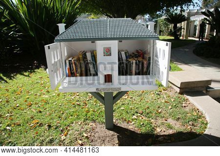 Pasadena, California, USA - March 26, 2021: Free Library at the Wrigley Mansion now Tournament House. This location is the permanent headquarters for the Tournament of Roses. Editorial Use Only.