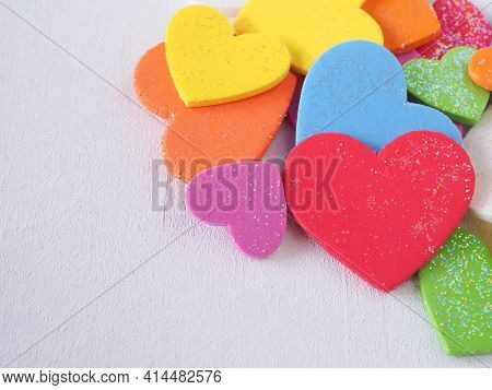 A Pile Of Colorful Hearts On A White Background. The Concept Valentine's Day, Anniversary, And Weddi