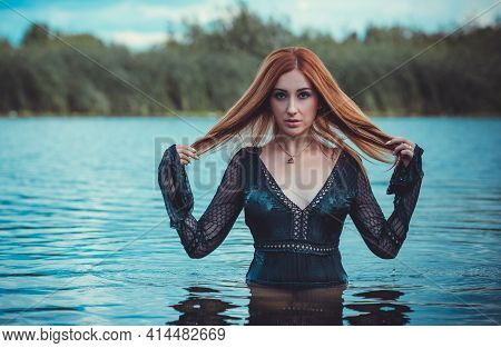 Sexy Mystical Woman In Black Bodysuit In Water. Concept Of Femininity And Sensual. Relax Concept. Wo