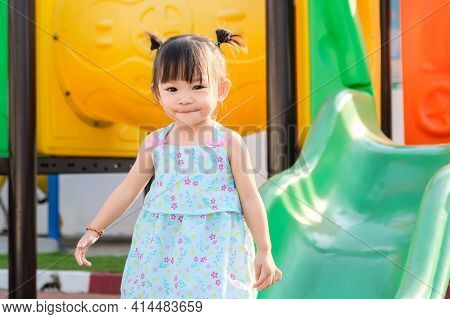 Portrait Image Of 1-2 Yeas Old Baby. Happy Asian Child Girl Smiling And Laughing. She Playing With S