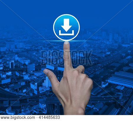 Hand Pressing Download Flat Icon Over Modern City Tower, Street, Expressway And Skyscraper, Technolo