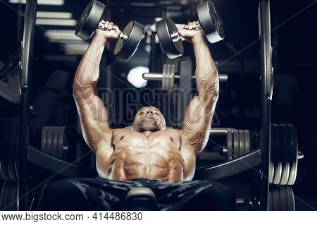 Fit Man Doing Bench Press At Gym.