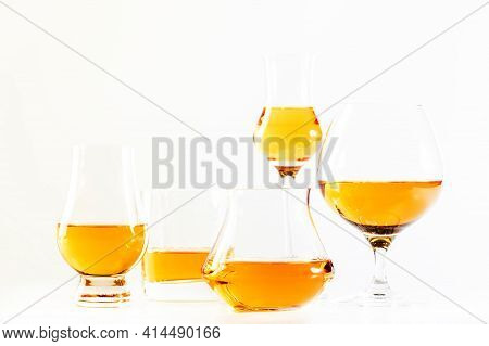Hard Strong Alcoholic Drinks And Distillates In Glasses And Shot Glass In Assortment: Vodka, Cognac,