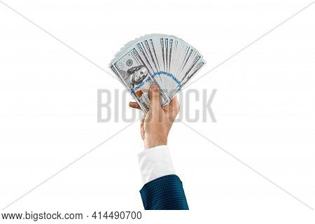 Man's Hand In A Business Suit Holds 100 Dollar Bills, Money In Hand Isolated On White Background. Bu