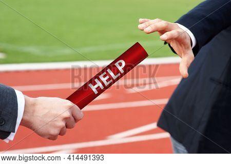 Businessmen Pass Help Assistance Baton In Relay Race In Stadium