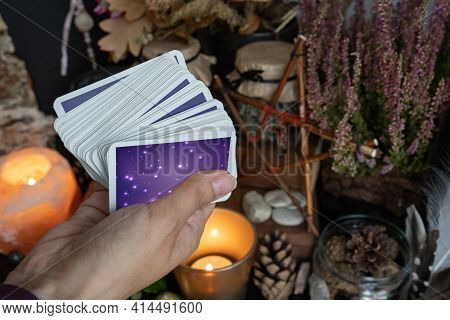 Woman Hand Is Holding Deck Of Tarot Or Oracle Cards Doing Fortunetelling.