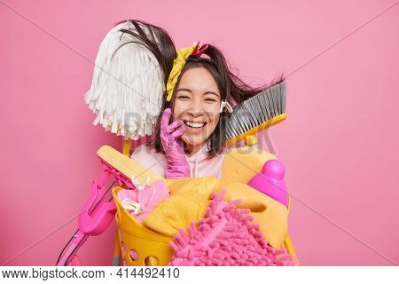 Happy Cheerful Housewife Foolishes Around While Doing House Cleanup Surrounded By Cleaning Supplies