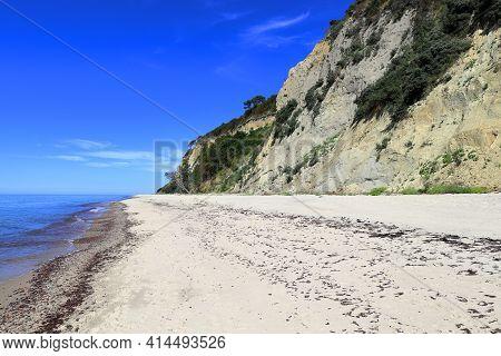 A Wide Sandy Beach Near A High Sandy Cliff Near The Blue Sea. Donskoye, Svetlogorsk District