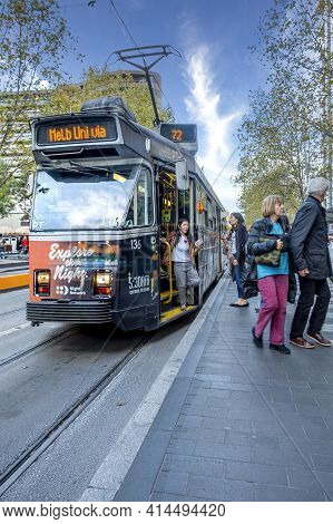 Melbourne, Australia - May 13, 2019: Classic City Tram Stopped At Station Along Swanston Street For