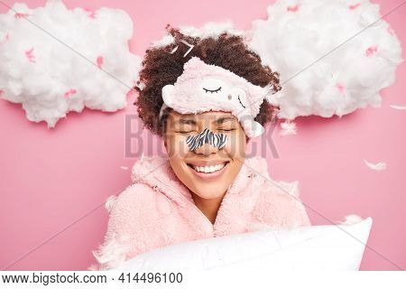 Positive Young Afro American Woman Smiles Toothily Keeps Eyes Closed Enjoys Morning Time After Good