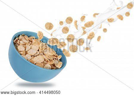 Bowl Of Corn Flakes With Milk Splash. Corn Flakes On Isolated White Background. Breakfast