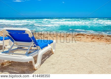 Beautiful Chaise Lounge By The Sea On Nature Background