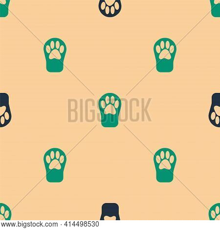 Green And Black Paw Print Icon Isolated Seamless Pattern On Beige Background. Dog Or Cat Paw Print.