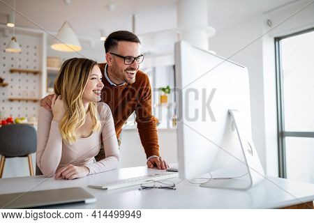 Happy Couple In Love Working Together On Computer.