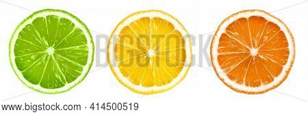 Isolated Citrus Slices. Fresh Fruits Cut In Half - Lime, Lemon And Orange In A Row Isolated On White