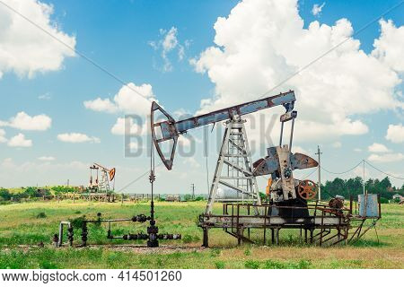 The Pumping Unit As The Oil Pump Installed On A Well. Equipment Of Oil Fields