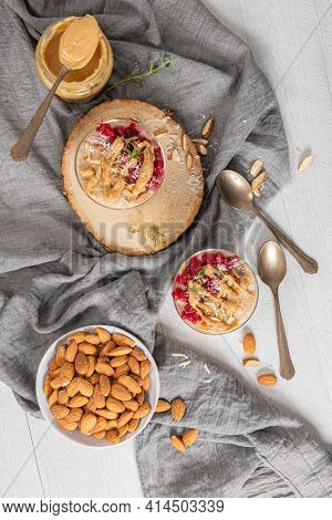 Breakfast Oatmeal Porridge With Raspberries, Almond, Cinnamon, Almond Butter And Coconut. Healthy Br